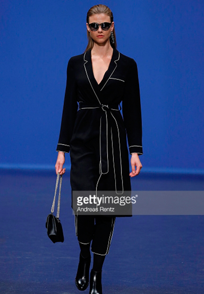 A model walks the runway at the Breuninger show during Platform Fashion July 2017 at Areal Boehler on July 21, 2017 in Duesseldorf, Germany.